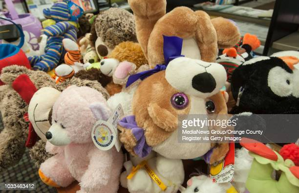 A plush pile of stuffed animals await their new homes as low income families and families of special needs children take part in the Shop and Wrap...