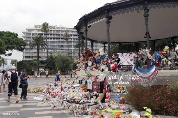 Plush toys and posters lie on the 'Promenade des Anglais' in Nice France 14 September 2016 A 31yearold Tunisian man had driven into a crowd on the...