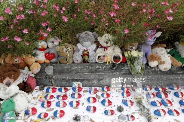 Plush toys and stones with inscription lie at the 'Promenade des Anglais' in Nice France 14 September 2016 A 31yearold Tunisian man had driven into a...