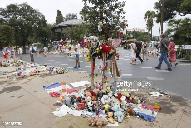 Plush toys lie at the 'Promenade des Anglais' in Nice France 14 September 2016 A 31yearold Tunisian man had driven into a crowd on the beach...