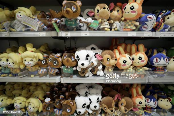 Plush toys of characters from the Nintendo Co. Video game Animal Crossing: New Horizons are displayed for sale inside the Nintendo TOKYO store in...