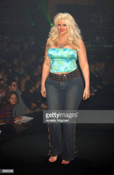 Plussize model Anna Nicole Smith has fun on the runway during the Lane Bryant Lingerie Fashion Show February 5 2002 in New York City