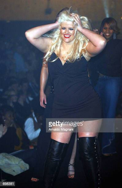 Plussize model Anna Nicole Smith performs on the runway during the Lane Bryant Lingerie Fashion Show February 5 2002 in New York City