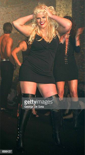 Plussize model Anna Nicole Smith poses on the runway during the Lane Bryant Lingerie Fashion Show February 5 2002 in New York City