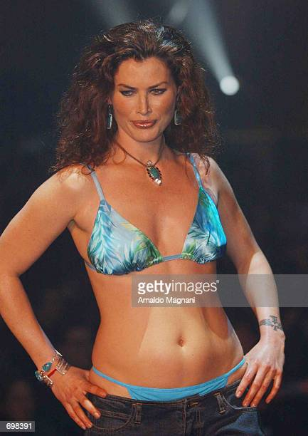 Plussize model Carre Otis walks the runway during the Lane Bryant Lingerie Fashion Show February 5 2002 in New York City