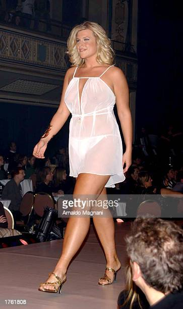 A plussize model walks on the runway during the Lane Bryant fashion show February 4 2003 at the Hammerstein Ballroom in New York City