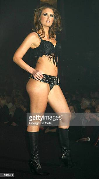 A plussize model walks the runway during the Lane Bryant Lingerie Fashion Show February 5 2002 in New York City