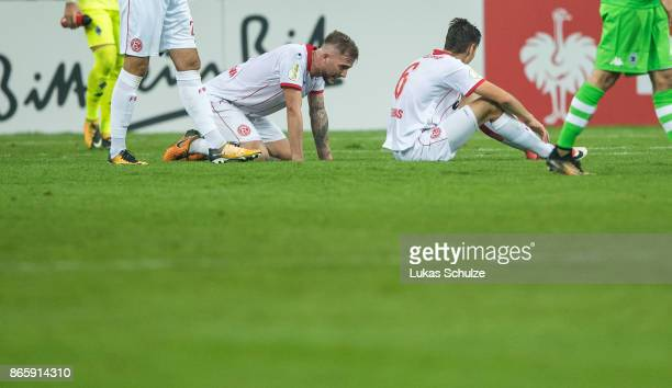 Plyers of Duesseldorf react after loosing the DFB Cup match between Fortuna Duesseldorf and Borussia Moenchengladbach at Esprit-Arena on October 24,...