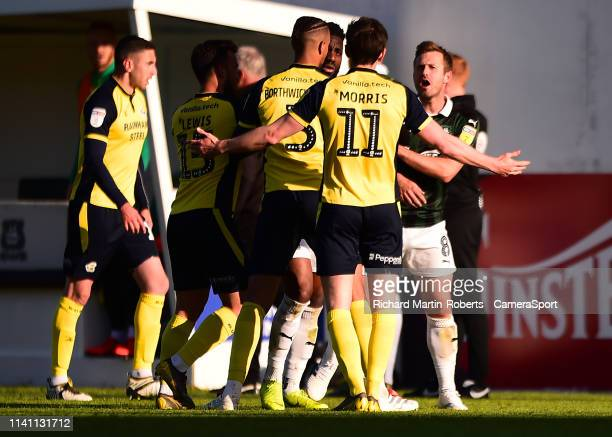 Plymouth and Scunthorpe players clash following Scunthorpe United's second goal scored by Josh Morris during the Sky Bet League One match between...