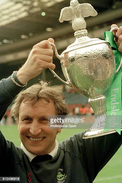 Plymouth Argyle manager Neil Warnock holding the trophy after their 10 victory over Darlington in the Division Three PlayOff Final at Wembley Stadium...