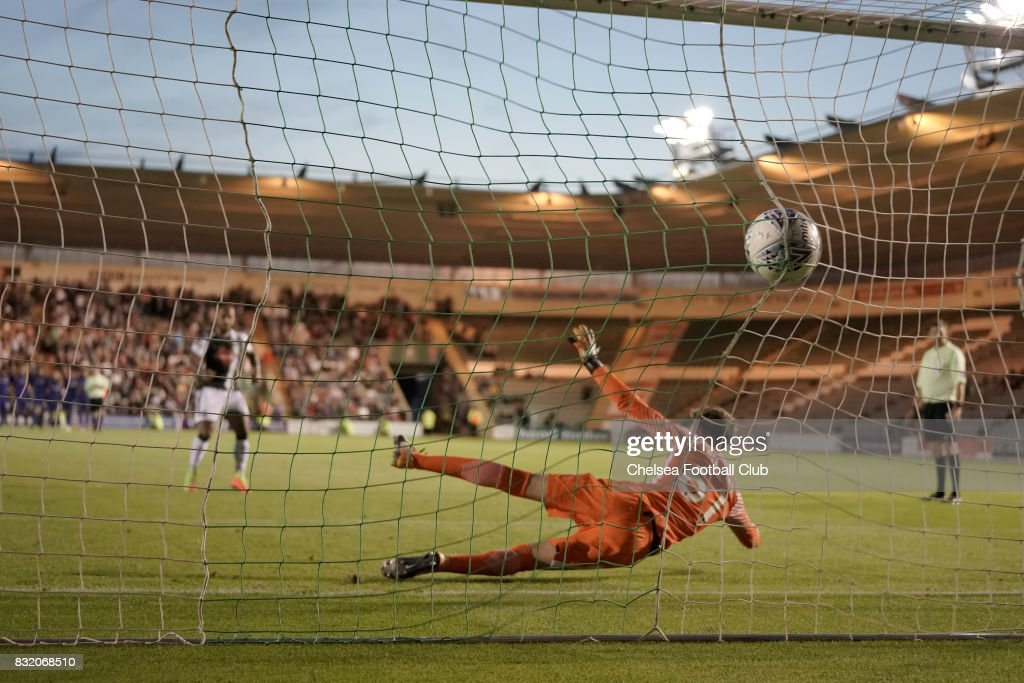 Plymouth Argyle score one of their five successful penalty kicks in the shoot out during the Checkatrade Trophy match at Home Park on August 15, 2017 in Plymouth, England.