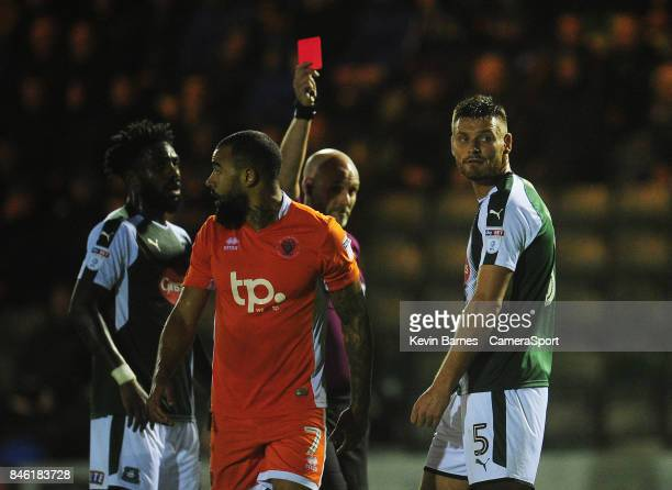Plymouth Argyle's Ryan Edwards is shown a red card by referee Kevin Johnson during the Sky Bet League One match between Plymouth Argyle and Blackpool...
