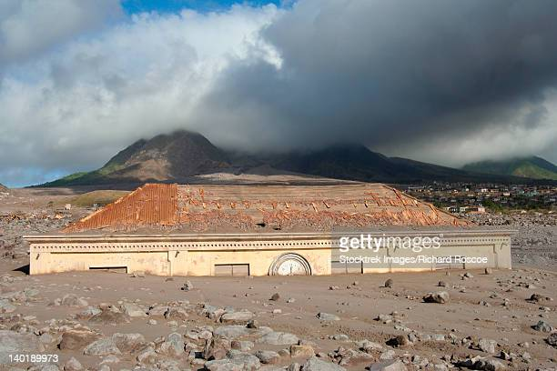 Plymouth Courthouse buried in lahar deposits from Soufriere Hills volcano, Montserrat, Caribbean.