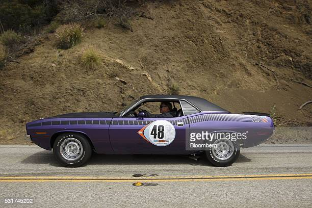 Plymouth Cuda hardtop drives during the Friends of Steve McQueen Car Show Rally from Malibu to Santa Barbara California US on Saturday May 14 2016...
