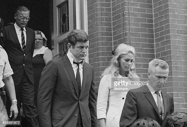 Sen Edward Kennedy leaves St Vincent's Church with his wife Joan after attending the funeral Mass celebrated for Mary Jo Kopechne who was killed in...