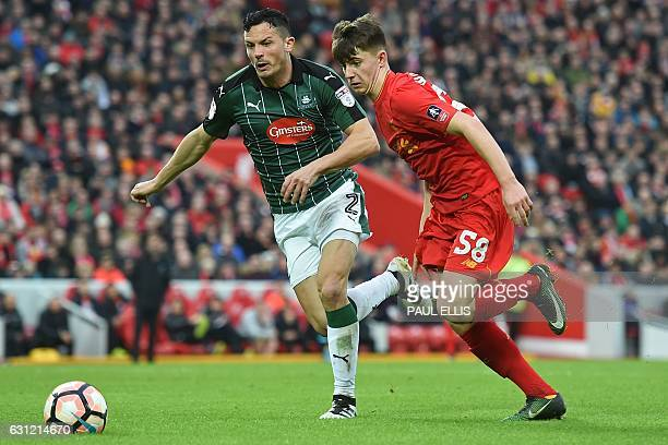Plymouth's Scottish defender Gary Miller vies with Liverpool's Welsh striker Ben Woodburn during the English FA Cup third round football match...