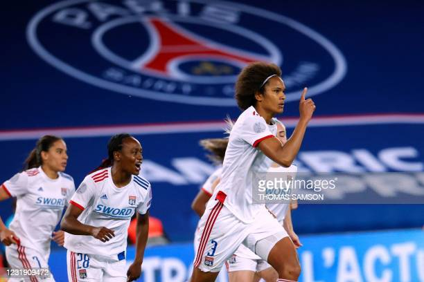 PLyon's French Defender Wendie Renard celebrates after scoring a penalty during the quater-final UEFA Women's Champions League football match between...
