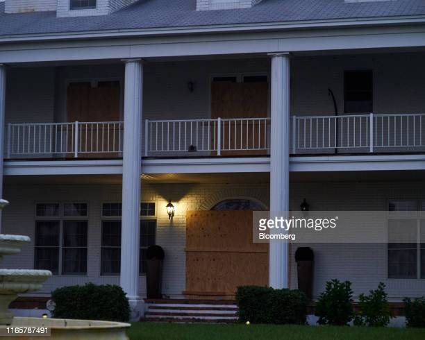 Plywood covers the windows of a house ahead of Hurricane Dorian in Titusville, Florida, U.S., on Monday, Sept. 2, 2019. Hurricane Dorian is...