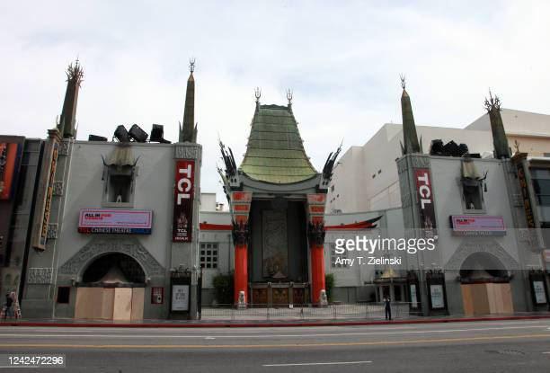Plywood is installed at Grauman's Chinese Theatre branded as TCL Chinese Theatre at the Hollywood Walk of Fame to cover up glass windows to protect...