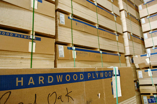 Plywood Is Stacked In A Warehouse At Austin Hardwoods Of Den