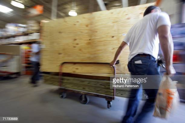 Plywood is wheeled out of a Home Depot in preparation for approaching Tropical Storm Ernesto August 28 2006 in Miami Florida Ernesto is projected to...