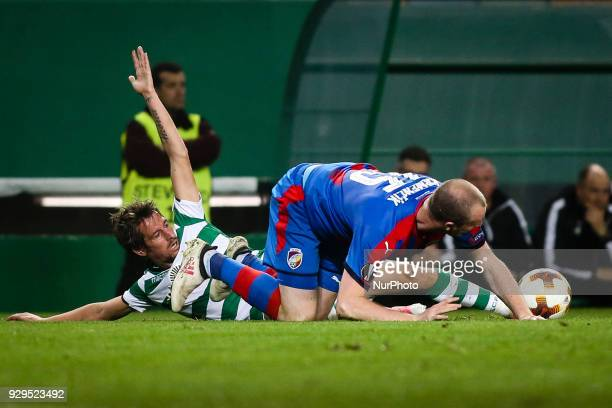 Plzen's forward Michal Krmencik vies with Sporting's defender Fabio Coentrao during the UEFA Europa League round of 16 match between Sporting CP and...