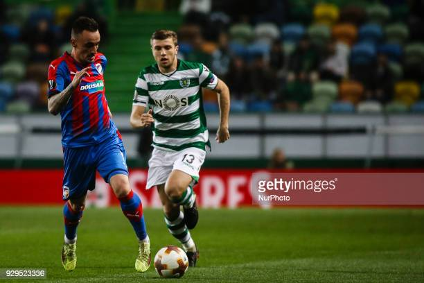 Plzen's midfielder Martin Zeman vies with Sporting's Macedonian defender Stefan Ristovski during the UEFA Europa League round of 16 match between...