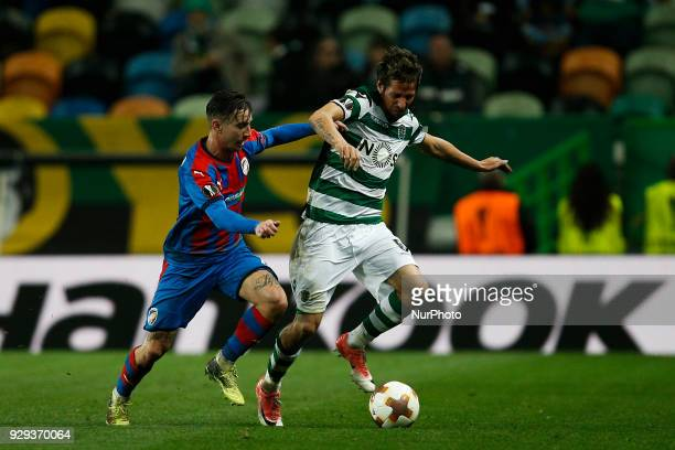 Plzen's midfielder Milan Petrzela vies for the ball with Sporting's defender Fabio Coentrao during UEFA Europa League football match between Sporting...