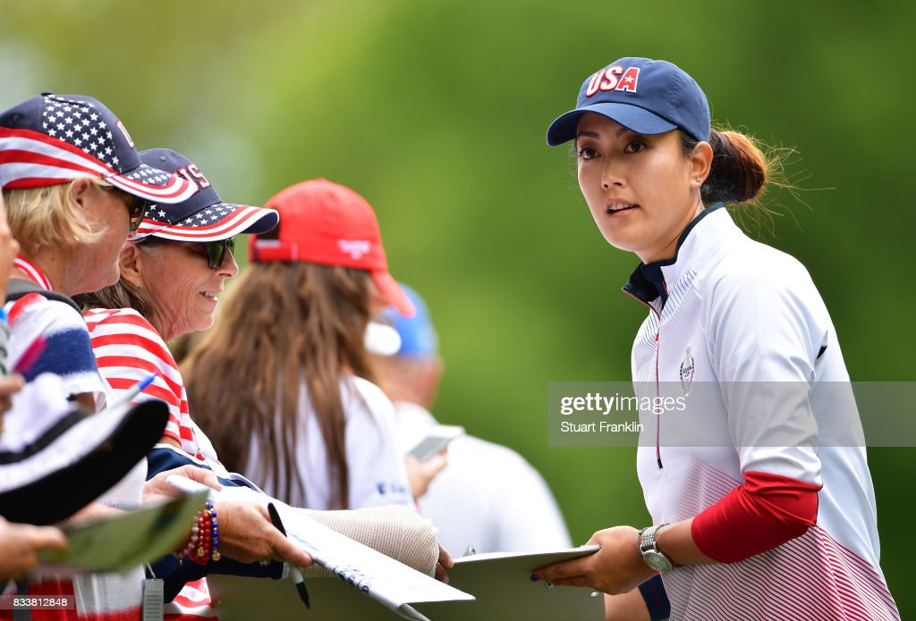 PMichelle Wie of Team USA signs autographs for fans during practice prior to The Solheim Cup at Des Moines Golf and Country Club on August 17, 2017 in West Des Moines, Iowa.