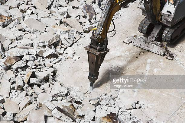 Pneumatic drill breaking concrete