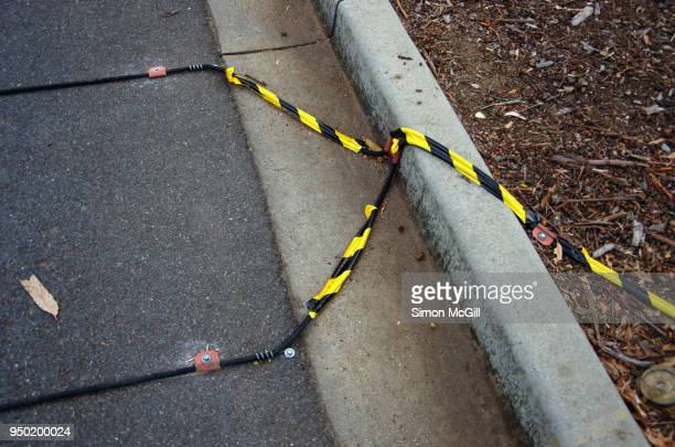 Pneumatic tubes of a traffic counter laid across a roadway to measure the number of vehicles