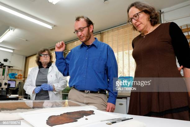 Pnina Shor curator and director of the Israel Antiquities Authority's Dead Sea scrolls and Oren Ableman the scroll researcher who examined scroll...