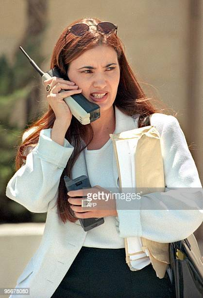 Pninat Yanai the former defence lawyer of Nahum Mambar who was convicted for selling weapons to Iran speaks in her mobile phones outside the Israeli...