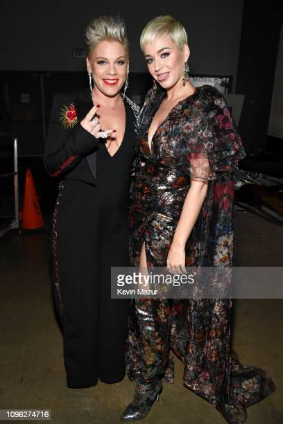 Pnk and Katy Perry attend MusiCares Person of the Year honoring Dolly Parton at Los Angeles Convention Center on February 8 2019 in Los Angeles...