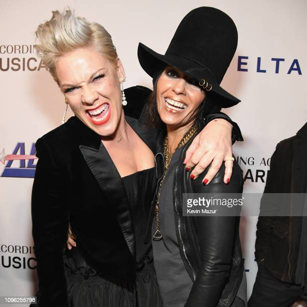 Pnk and Linda Perry attend MusiCares Person of the Year honoring Dolly Parton at Los Angeles Convention Center on February 8 2019 in Los Angeles...
