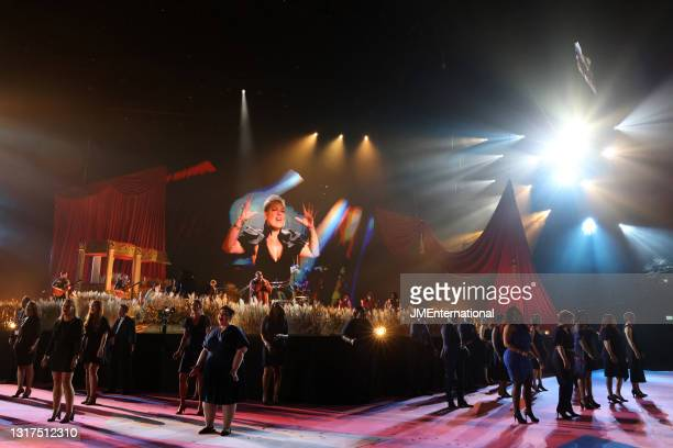 Nk and Rag'n'Bone Man perform with the Lewisham and Greenwich NHS Trust Choir during The BRIT Awards 2021 at The O2 Arena on May 11, 2021 in London,...