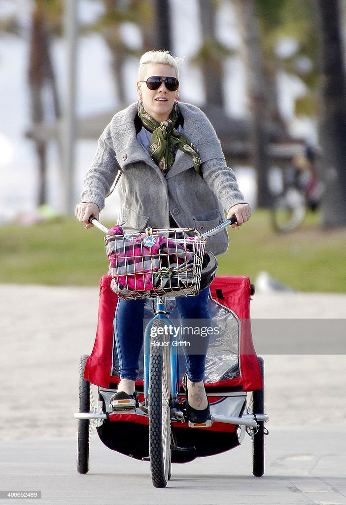 P!nk is seen taking a bike ride at the beach with her daughter Willow Hart riding along in a bike Trailer on February 02, 2014 in Los Angeles, California.
