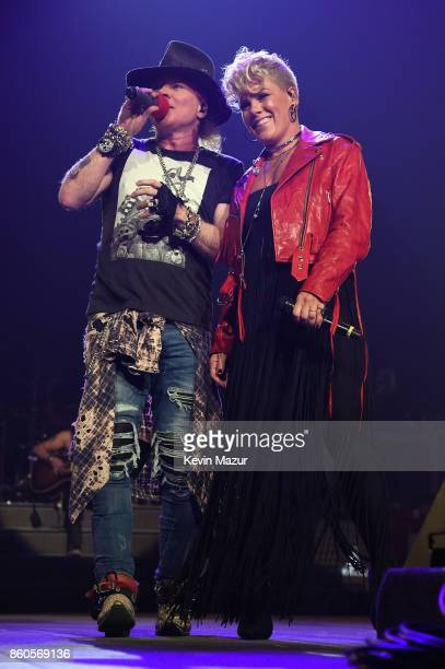 """Nk performs onstage with Axl Rose of Guns N' Roses during the """"Not In This Lifetime..."""" Tour at Madison Square Garden on October 11, 2017 in New York..."""