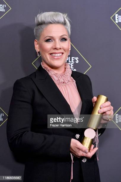 Nk, winner of People's Champion Award poses in the press room during the 2019 E! People's Choice Awards at Barker Hangar on November 10, 2019 in...