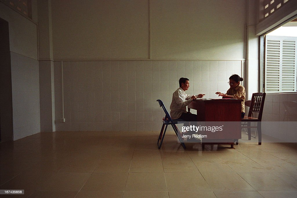 Po Kith Ly, left, talks with his psychiatrist, Ang Sody, in a new examination room at the Preah Norodom Sihanouk Hospital in Phnom Penh. Po Kith Ly was imprisoned and tortured by the Khmer Rouge between 1975 and 1979. He now has a hard time sleeping and is always nervous. He came from his home in Kandal province for his monthly appointment and psychiatric prescriptions. The Psychiatric Outpatient Department at the hospital draws several hundred patients a day from Phnom Penh and the surrounding provinces..