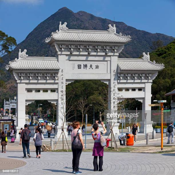 po lin monastery's gate in lantau island - gwengoat stock pictures, royalty-free photos & images