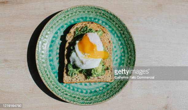poached egg, avocado on toast - egg stock pictures, royalty-free photos & images