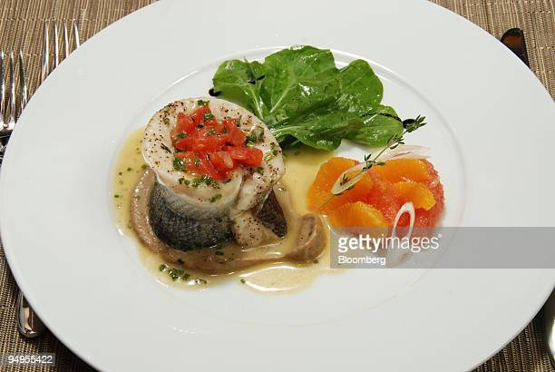 Poached filet of branzino with tomato concasse, blood orange salad, extra virgin olive oil and eggplant licorice coulis is shown at Montenapo...
