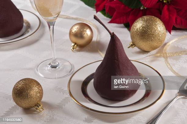 poached pear and champagne - ian gwinn stockfoto's en -beelden