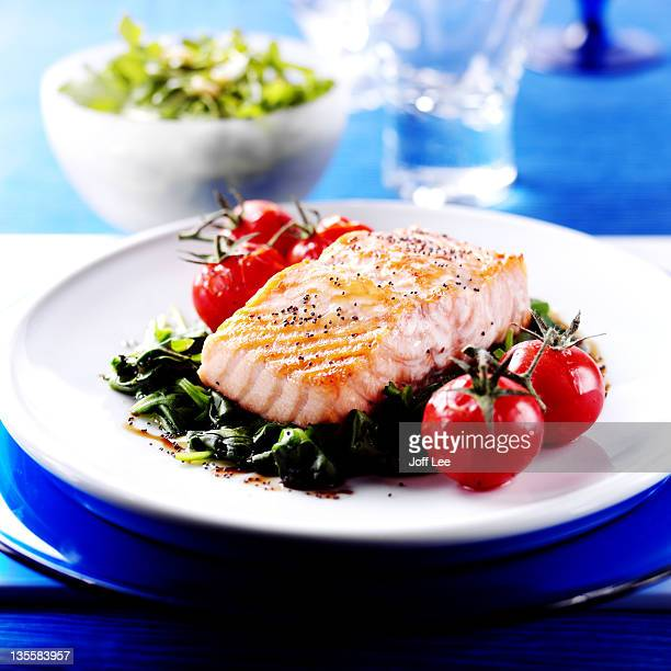 Poached salmon on a bed of spinach
