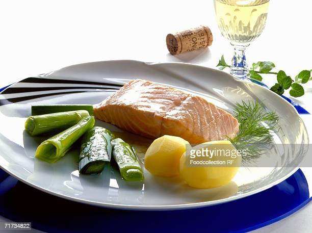Poached salmon with boiled potatoes and leeks