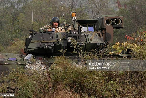 A US tank commander sits atop his M2 Bradley fighting vehicle during a mechanized military exercise at the Yeongpyeong River in Pocheon near the DMZ...