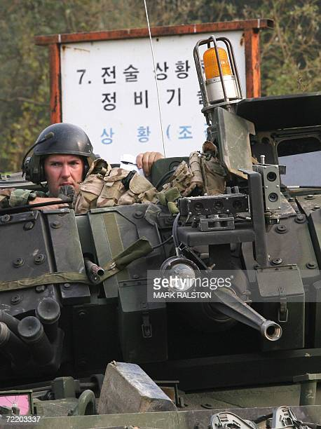 Pocheon, REPUBLIC OF KOREA: A US tank commander sits atop his M2 Bradley fighting vehicle during a mechanized military exercise at the Yeongpyeong...