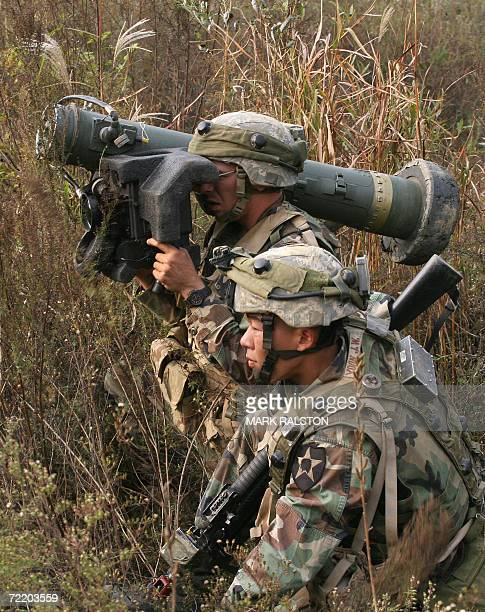 Pocheon, REPUBLIC OF KOREA: CORRECTION-CITY SPELLING IN IPTC FIELD A US soldier monitors a target with his anti-tank missile launcher next to his...