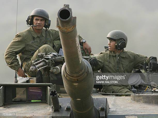 Pocheon, REPUBLIC OF KOREA: CORRECTION-CITY SPELLING IN IPTC FIELD A US tank commander sits atop his M1 Abrahams tank next a crewman during a...